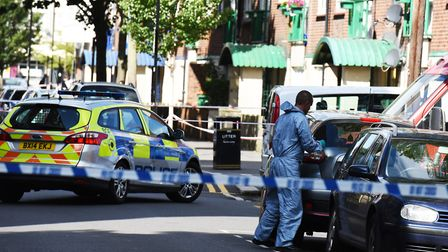 Police at the scene of a shooting in Woodman Street North Woolwich