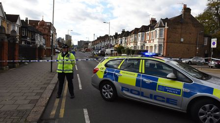 Police standing guard at the junction of Ilford High Road and Connaught Road on Monday, November 13. Picture: Ken Mears