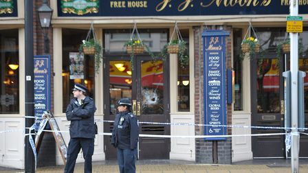 Police at JJ Moon's pub in Hornchurch, where Aiden O'Mahony was stabbed after going to watch an FA cup football match.