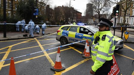 Police and forensic teams at the scene of the shooting in Romford Road, Stratford. Picture: Ken Mears