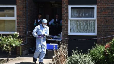 Police and forensic team at the scene of the murder in Straight Road Harold Hill