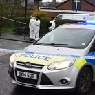 Police and a forensic team at the shooting on Collier Row Road