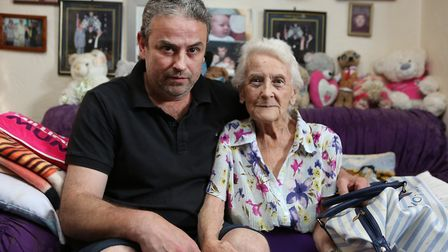 Jean Hurley, 83, and her son Andrew Hurley, 46. Jean was conned out of her life savings by a man posing to be a gardener.