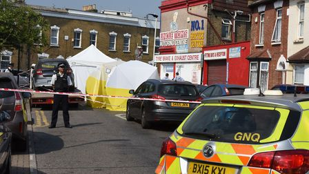 Police and a forensic team investigate a shootout in Bective Road, Forest Gate. Picture: Ken Mears