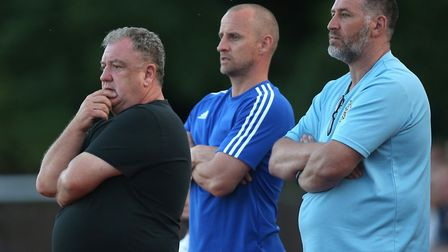 Colin McBride (L), Jamie Southon and Hornchurch manager Jim McFarlane look on during AFC Hornchurch vs Arsenal Under-23...