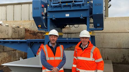 The new cable granulator machine, for use in recycling, at Sackers in Great Blakenham. Adrian Dodds, left, and David...