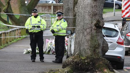 Police at the scene of the murder of 17 year old Jodie Chesney where floral tributes have been left.
