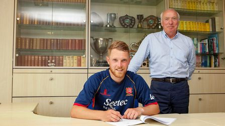 Jamie Porter of Essex signs his new contract as Derek Bowden looks on during Essex CCC vs Somerset CCC, Specsavers County Cha...