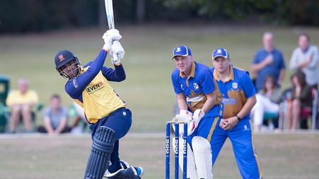 Essex batsman Rishi Patel hits out as Upminster's Mick Larke and Ollie Peck look on (pic Ray Lawrence/TGS Photo)
