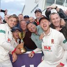 Aaron Beard (L) and Jamie Porter of Essex celebrate with the Essex fans after clinching the Championship during Somerset...