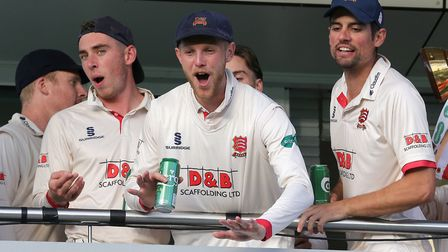Jamie Porter of Essex (C) leads the Championship celebrations on the dressing room balcony during Somerset CCC vs Essex...