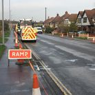 View of Middleton Road in Gorleston with roadworks sign and traffic cones along the kerb.