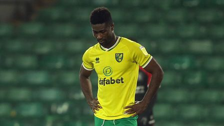 Alexander Tettey of Norwich looks dejected after his side concedes it's 1st goal late on during th