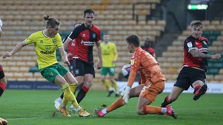 Ben Wilson of Coventry City denies Przemyslaw Placheta of Norwich with a point blank save during the