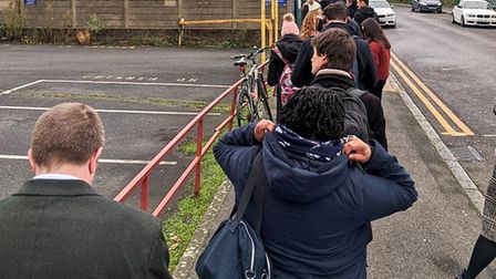A queue outside a polling station in East London as voters line up to cast their votes in the Genera