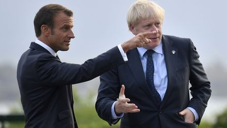 French president Emmanuel Macron speaks to British prime minister Boris Johnson. Photograph: Neil Ha