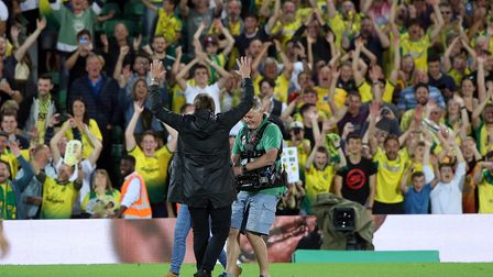 Norwich Head Coach Daniel Farke celebrates victory with the fans at the end of the Premier League ma