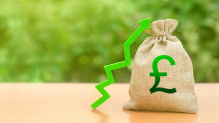 Money bag with pound sterling symbol and green up arrow. The growth of the national economy and the