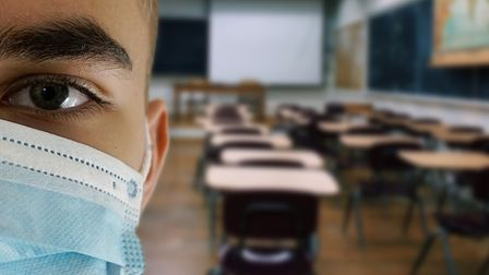 Student wearing a face mask in a school classroom