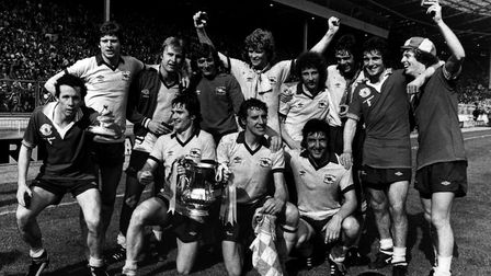 Arsenal celebrate winning the FA Cup in 1979, standing left to right Liam Brady, Steve Walford, David Price, Pat Jennings,...