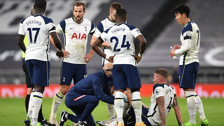 Tottenham Hotspur's Toby Alderweireld (sitting) receives receives treatment for an injury during the Premier League match...