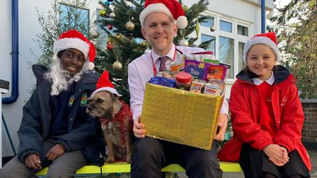 Executive headteacher Dan Hawkins with Nabil from Claremont, Olivia from Childs Hill and Dusty the dog. The two Barnet...