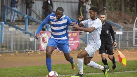Larry Akanbi of Ilford holds off the challenge during Ilford vs Woodford Town, Essex Senior League Football at Cricklefields ...
