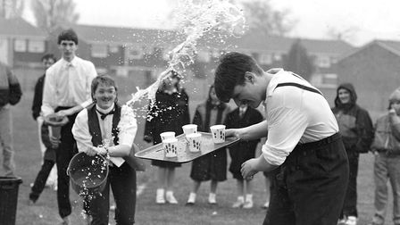 Despite the falling rain the Chantry pupils still had fun with throwing water during Rag Week in 1988 Picture: ARCHANT
