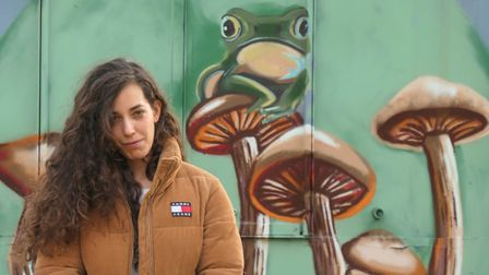 Local artist Alba Bernal with her brightly painted murals which have cheered up the Sunnyside Community Garden in...