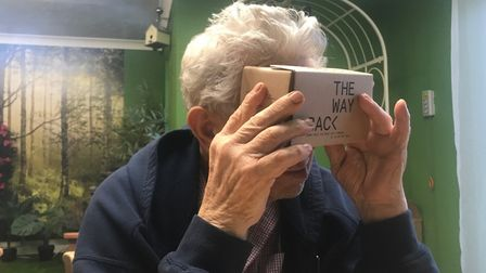 An eager OAP tests out the Wayback VR film. Picture: The Wayback VR