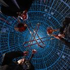 Brass musicians from the Royal Philharmonic Orchestra play inside London tallest LED Christmas tree, named Aurora Arbour...