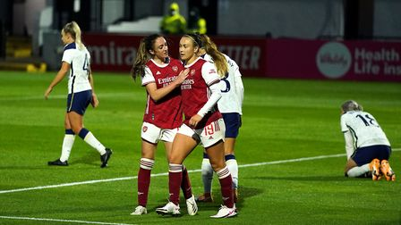 Arsenal's Lisa Evans (left) celebrates scoring her side's fourth goal of the game and hat-trick during the Barclays FA WSL...
