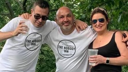 Danny Alexis, Tony Hassan and Cassie Shortlander celebrateb The Nobody Inn. Picture: Tony Hassan