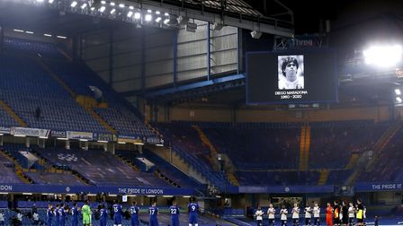 Chelsea and Tottenham players stand for a minute's applause in remembrance of Diego Maradona prior to the beginning of the...