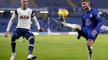 Chelsea's Timo Werner (right) and Tottenham Hotspur's Joe Rodon battle for the ball