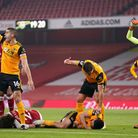 Players reacts after Arsenal's David Luiz (left, floor) clashes heads with Wolverhampton Wanderers' Raul Jimenez (right...