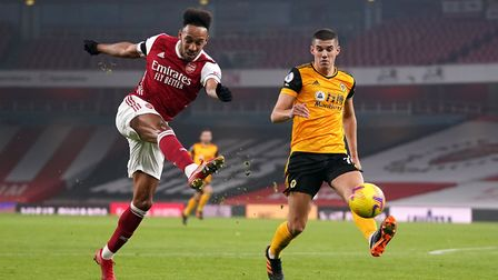 Arsenal's Pierre-Emerick Aubameyang (left) has a shot at goal as Wolverhampton Wanderers' Conor Coady looks on