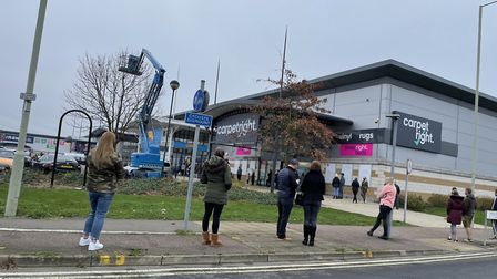 Shoppers maintained social distancing along the queue, which stretched out of the car park Picture: CHARLOTTE BOND
