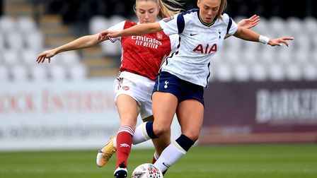 Tottenham Hotspur's Rianna Dean (right) and Arsenal's Leah Williamson battle for the ball during the FA Women's Super...