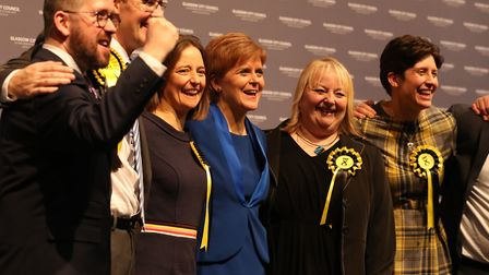 First minister Nicola Sturgeon celebrates with some of her newly elected MPs. Photograph: Andrew Mil