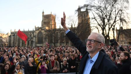 Labour Party leader Jeremy Corbyn waves to supporters after speaking at a rally outside Bristol City