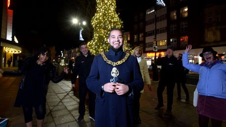Mayor of Haringey Cllr Adam Jogee with the Muswell Hill Christmas Tree celebrates the lighting with