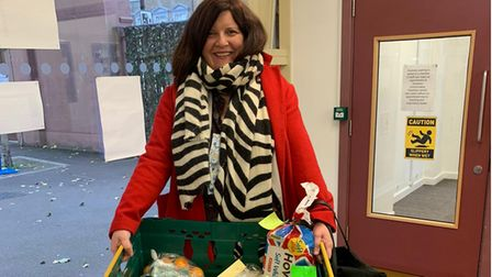Hackney New School Headteacher Charlotte Whelan holds a food package she will deliver to isolating families.