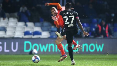 Alexander Tettey of Norwich has a shot on goal during the Sky Bet Championship match at Kenilworth R