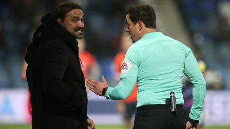 Referee Darren England has words with Norwich Head Coach Daniel Farke during the Sky Bet Championshi
