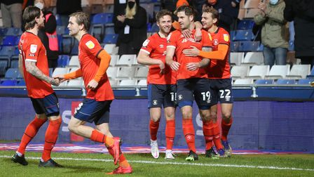 James Collins of Luton Town celebrates scoring his side's 3rd goal from the penalty spot during the
