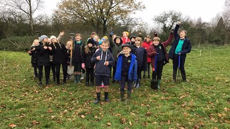 Pupils from Corpusty Primary School planted saplings near the local village hall.