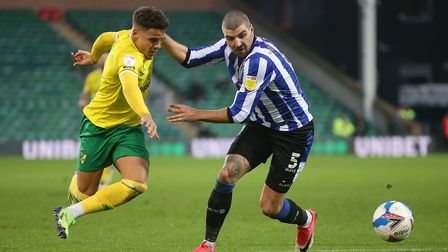 Max Aarons of Norwich and Callum Paterson of Sheffield Wednesday in action during the Sky Bet Champi
