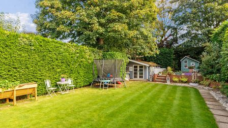 The mature rear garden is mainly laid to lawn. Picture: Cassidy & Tate
