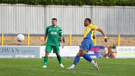 Joe Chidyausiku scores St Albans City's fifth in the FA Cup match with Hitchin Town. Picture: DANNY LOO